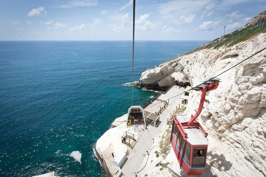 Taking the Cabel Car to the grrotoes, Rosh Hanikra.